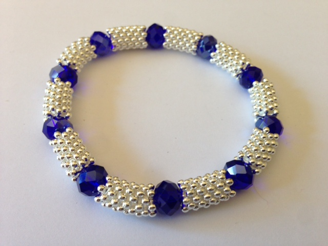 Crystal Glass Bead With Snowflake Spacer Stretch Bracelet Sapphire Blue Colour